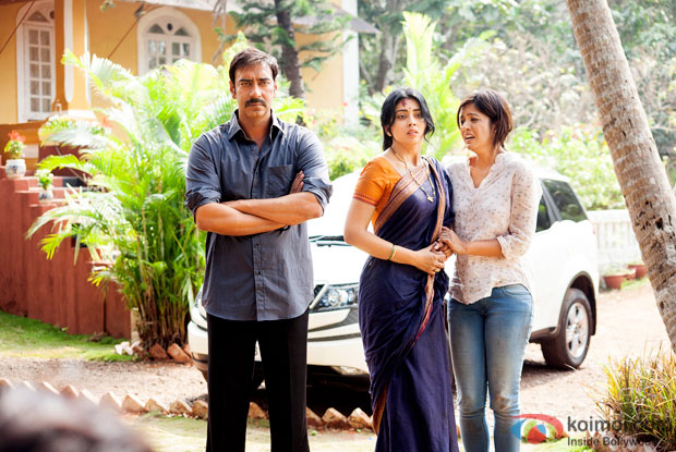 Ajay Devgn and Shriya Saran in a still from on the sets of movie 'Drishyam'