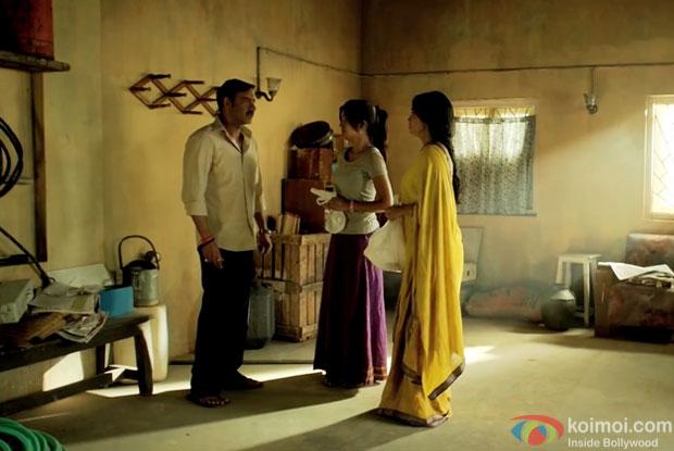 Ajay Devgn, Ishita Dutta and Shriya Saran in a still from movie 'Drishyam'