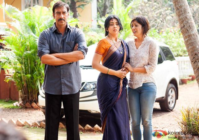 Ajay Devgn and Shriya Saran in a still from movie 'Drishyam'