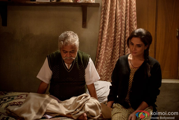 Sanjay Mishra and Richa Chadda in a still from movie 'Masaan