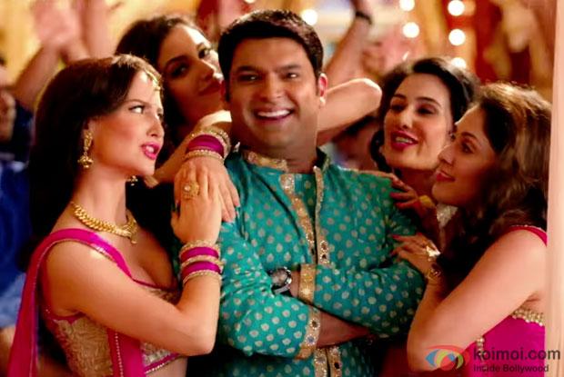 Kapil Sharma matching steps with his co stars Elli Avram, Manjari Phadnis, Simran Kaur Mundi and debutant Sai Lokurin in song 'DJ Bajega Toh Pappu Nachega' from movie 'Kis Kis Ko Pyaar Karoon'