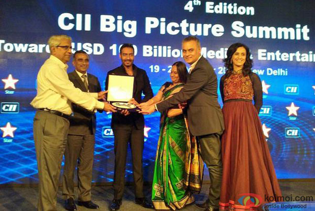 CII Awards Ajay Devgn with Award for Excellence in Indian Cinema