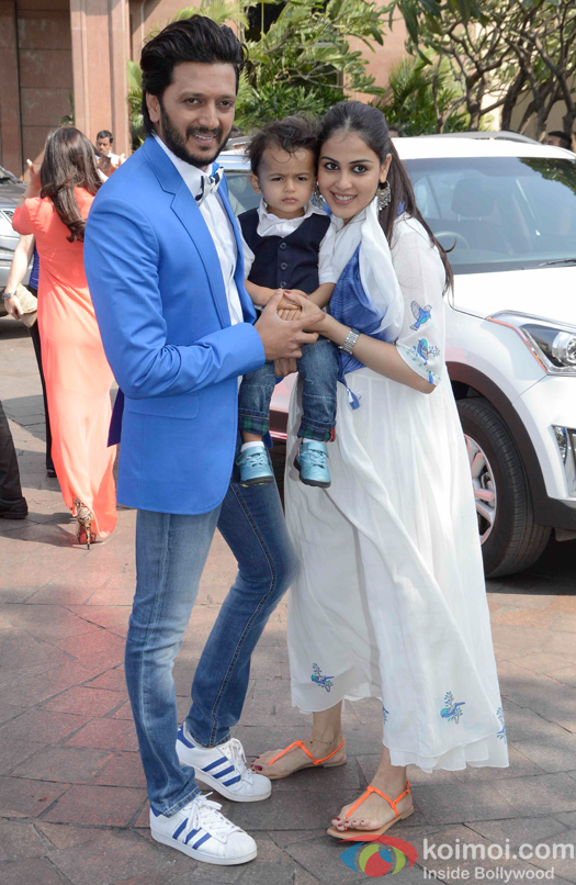 Riteish Deshmukh with his son Riaan and wife Genelia D'Souza during Arpita Khans baby shower ceremony