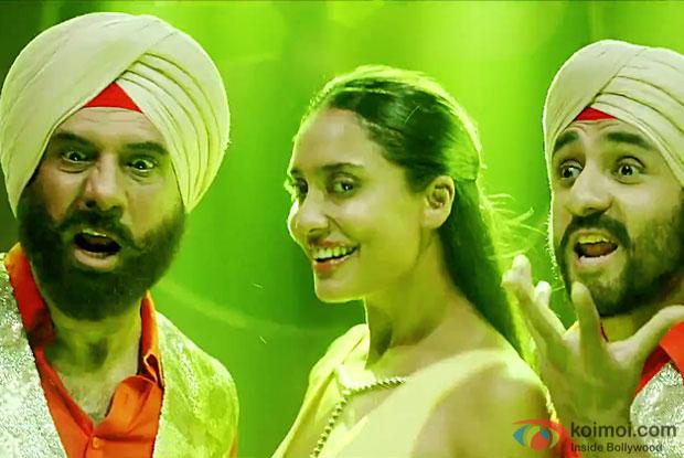 Boman Irani, Lisa Haydon and Vir Das in a Hit Kardi song still from Santa Banta Pvt. Ltd.