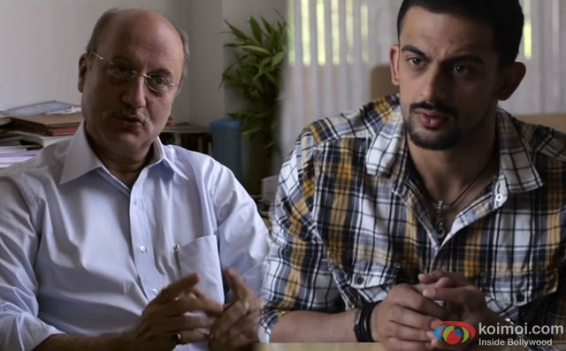 Anupam Kher and Arunoday Singh in a still from movie 'Buddha In A Traffic Jam'