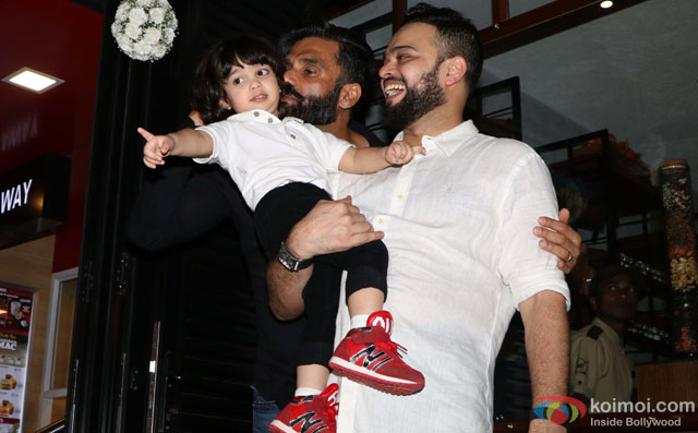Suniel Shetty and Farhan Azmi with his son during the Launch of Cafe Basilico