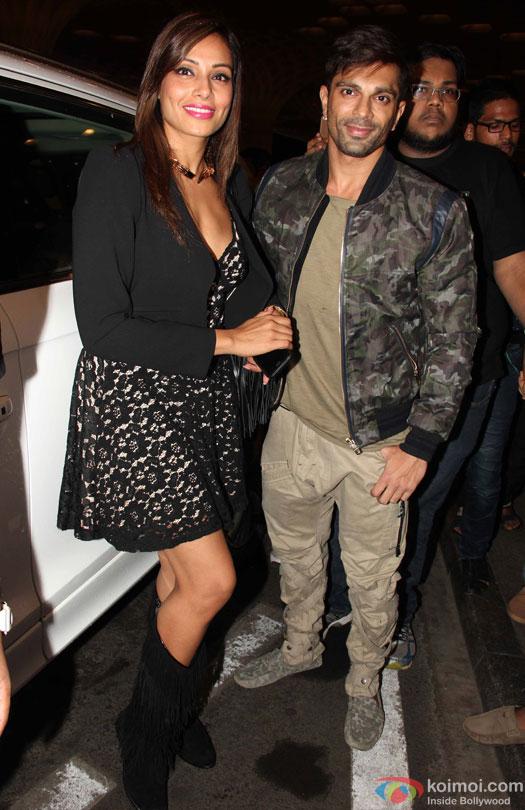 Bipasha Basu and Karan Singh Grover at airport leave for IIFA 2016