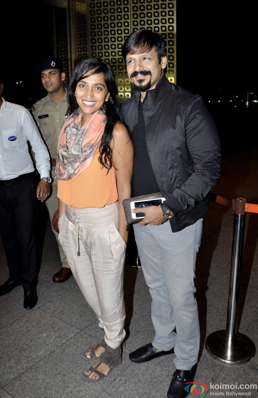 Priyanka Alva Oberoi and Vivek Oberoi at airport leave for IIFA 2016