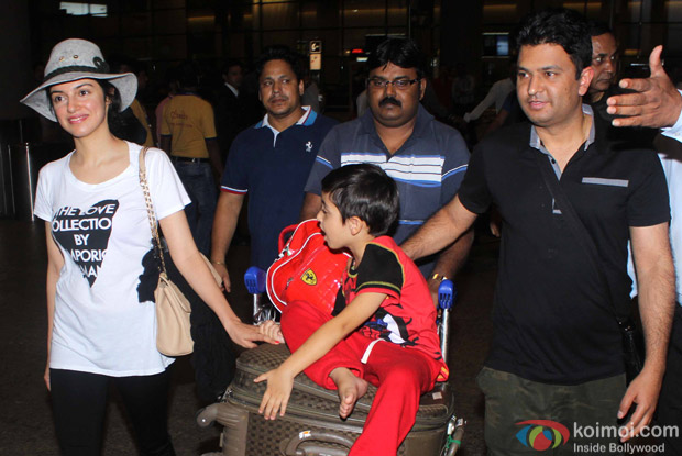 Bhushan Kumar, Divya Khosla Kumar and Son Ruhaan Kumar at International Airport