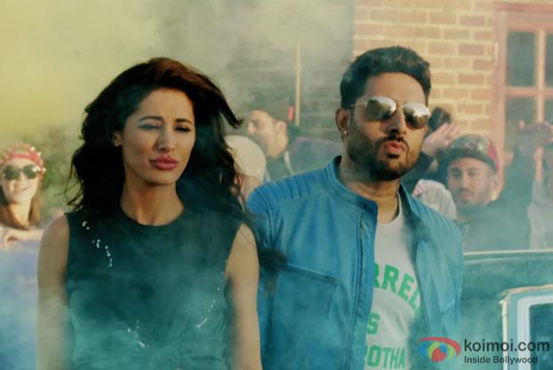 Nargis Fakhri and Abhishek Bachchan in a still from Housefull 3