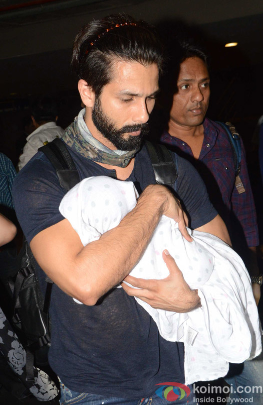 Shahid kapoor with baby daughter Misha spotted at airport