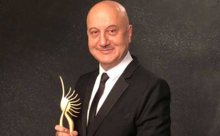 Anupam Kher dedicates award to struggling actors without godfathers