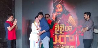 PICS: Tamannaah Bhatia With Chiranjeevi & Ram Charan At Success Meet Event Of Sye Raa Narasimha Reddy