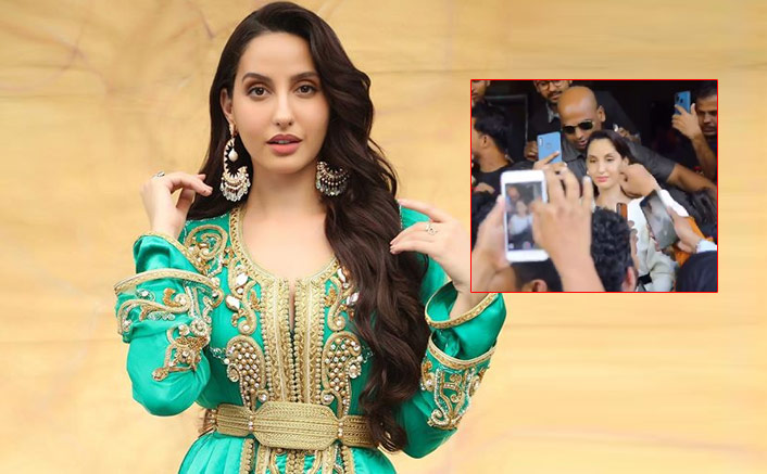Moroccan beauty Nora Fatehi flanked by her fans at the trailer launch of Street Dancer 3D