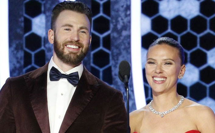 Captain America Saves The Day! Chris Evans Holds Scarlett Johansson with her dress at the Golden Globes