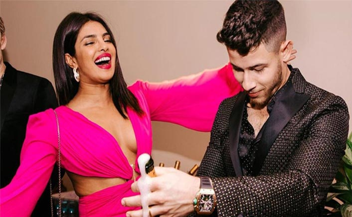This is how much Priyanka's neon pink cutout gown costs