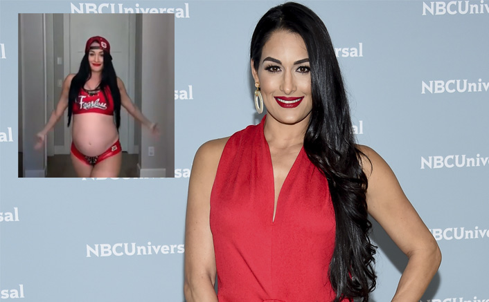 WWE Star Nikki Bella Flaunts Her Baby Bump As She Recreates Her Entry