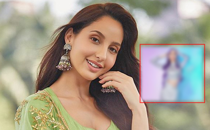 Nora Fatehi Looks Like A Mermaid With Lilac Hair & Shimmery Outfit On The Poster Of Her Upcoming Song