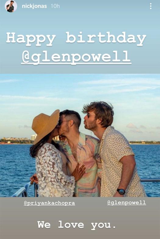 Priyanka Chopra Jonas & Nick Jonas Are Too Busy Kissing To Notice Glen Powell Mimicking Them