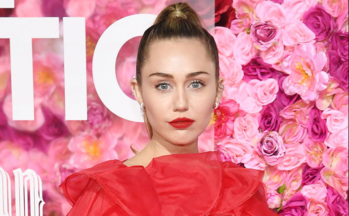 Miley Cyrus poses nude for Indian American lensman's photo book