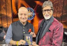 Anupam Kher gifts his latest book to Amitabh Bachchan