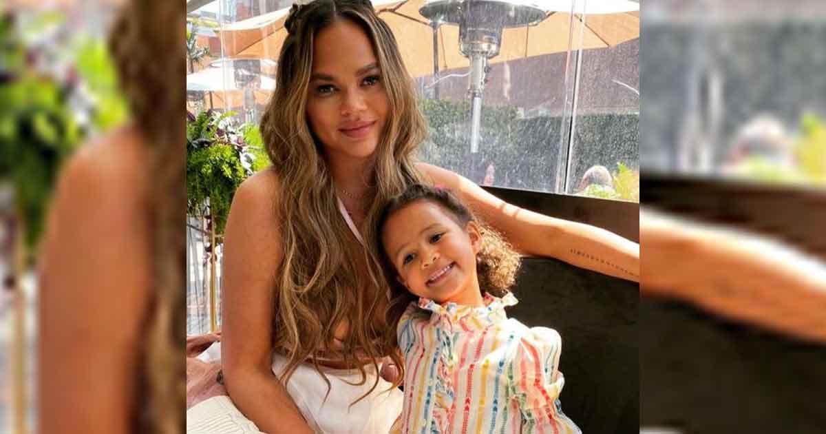 Chrissy Teigen, daughter Luna twin in black bikinis