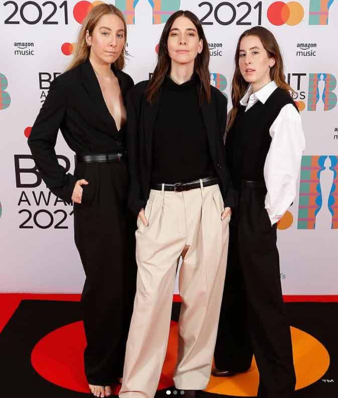 Haim Sisters Slay In Monochromatic Trouser & Work Shirt