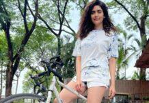 Karishma strikes a pose with her bike
