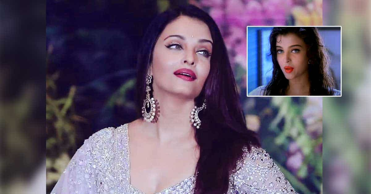 """Aishwarya Rai Bachchan and the story of """"5 Persuading Men"""".  Wearing red lipstick with wet hair to be sensual for an ad."""