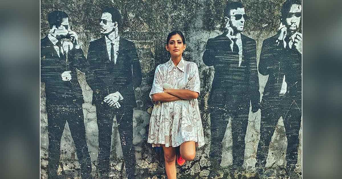 Kubbra Sait shares a cool picture against a wall mural