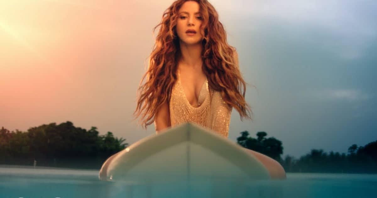 Shakira Sets The Temperature Soaring As She Surfs & Poses In A Golden Bikini