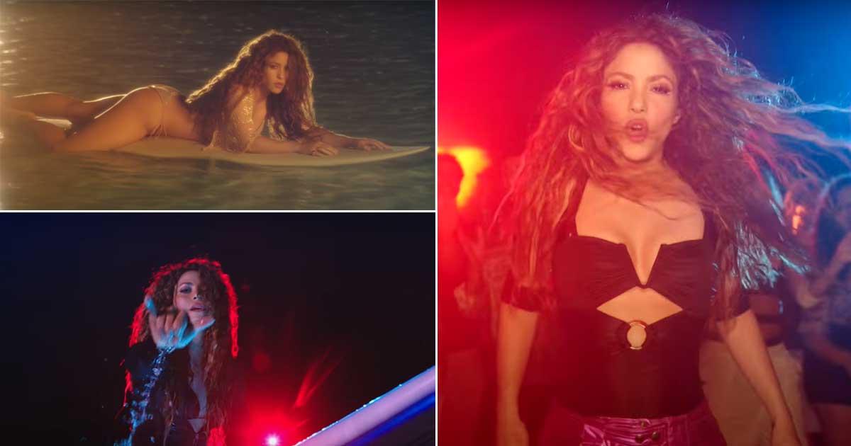 Shakira lying on the beach in a bright bikini using a surfboard Issa Mood!
